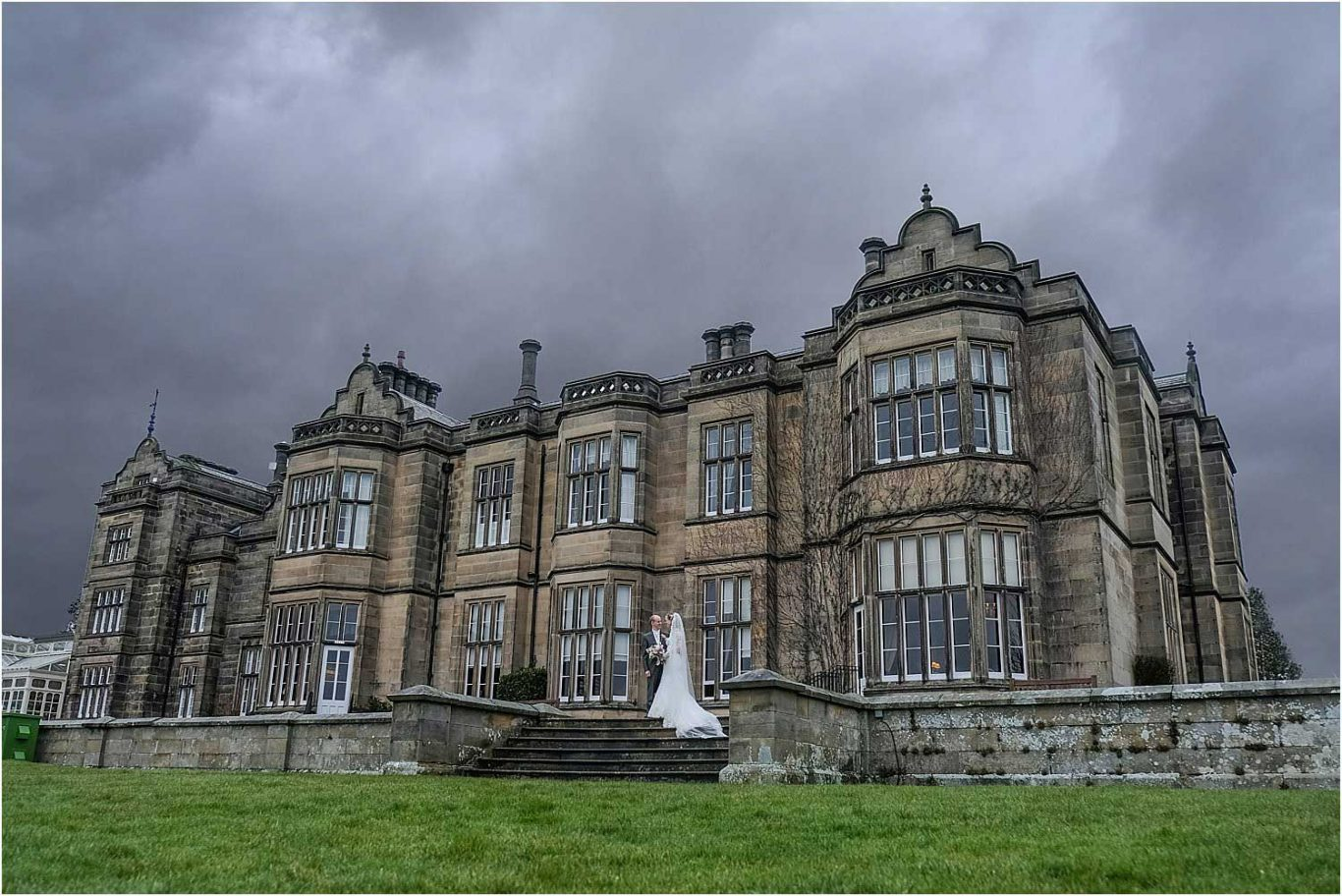 bride and groom outside of stately home