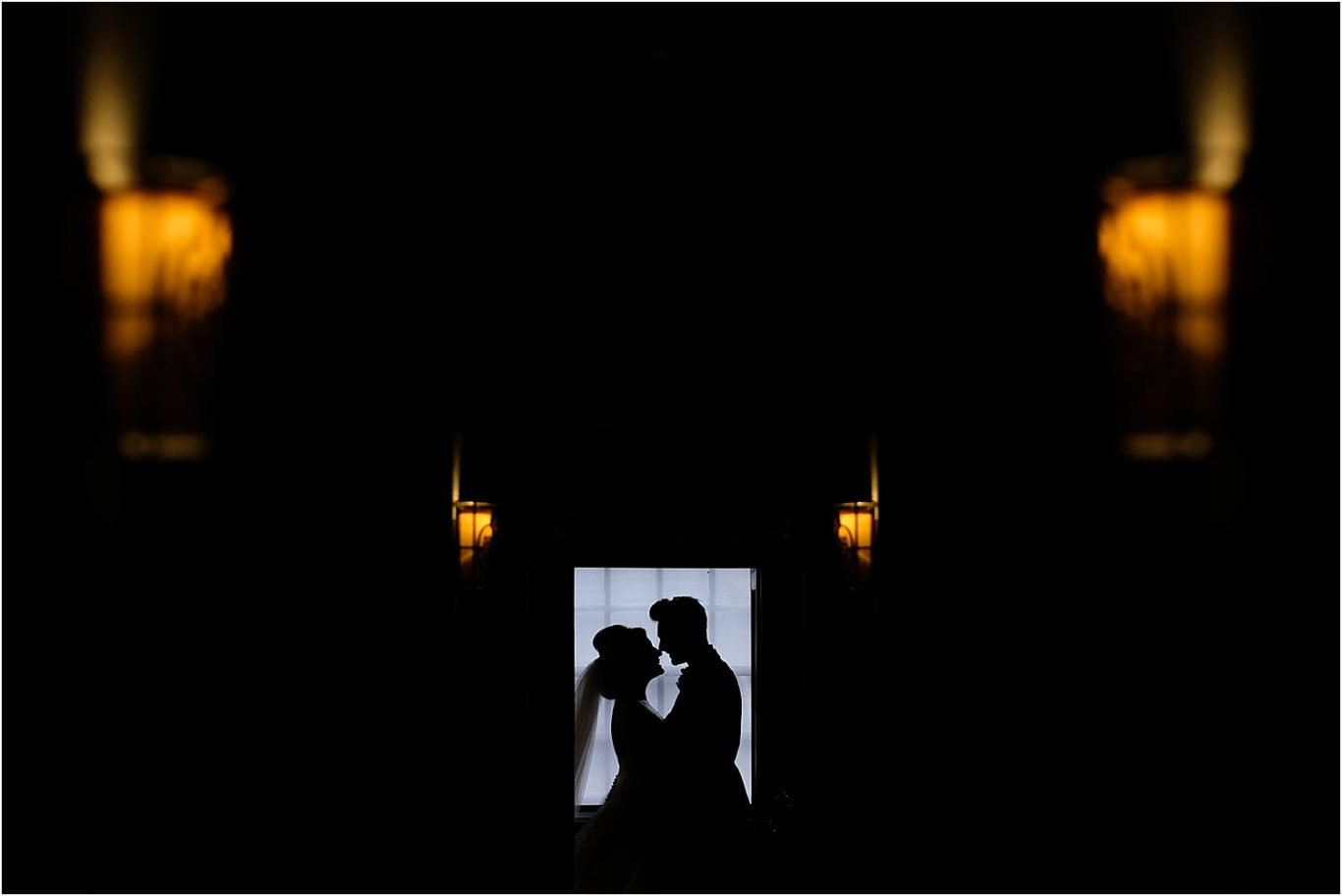 bride and groom silhouette in window
