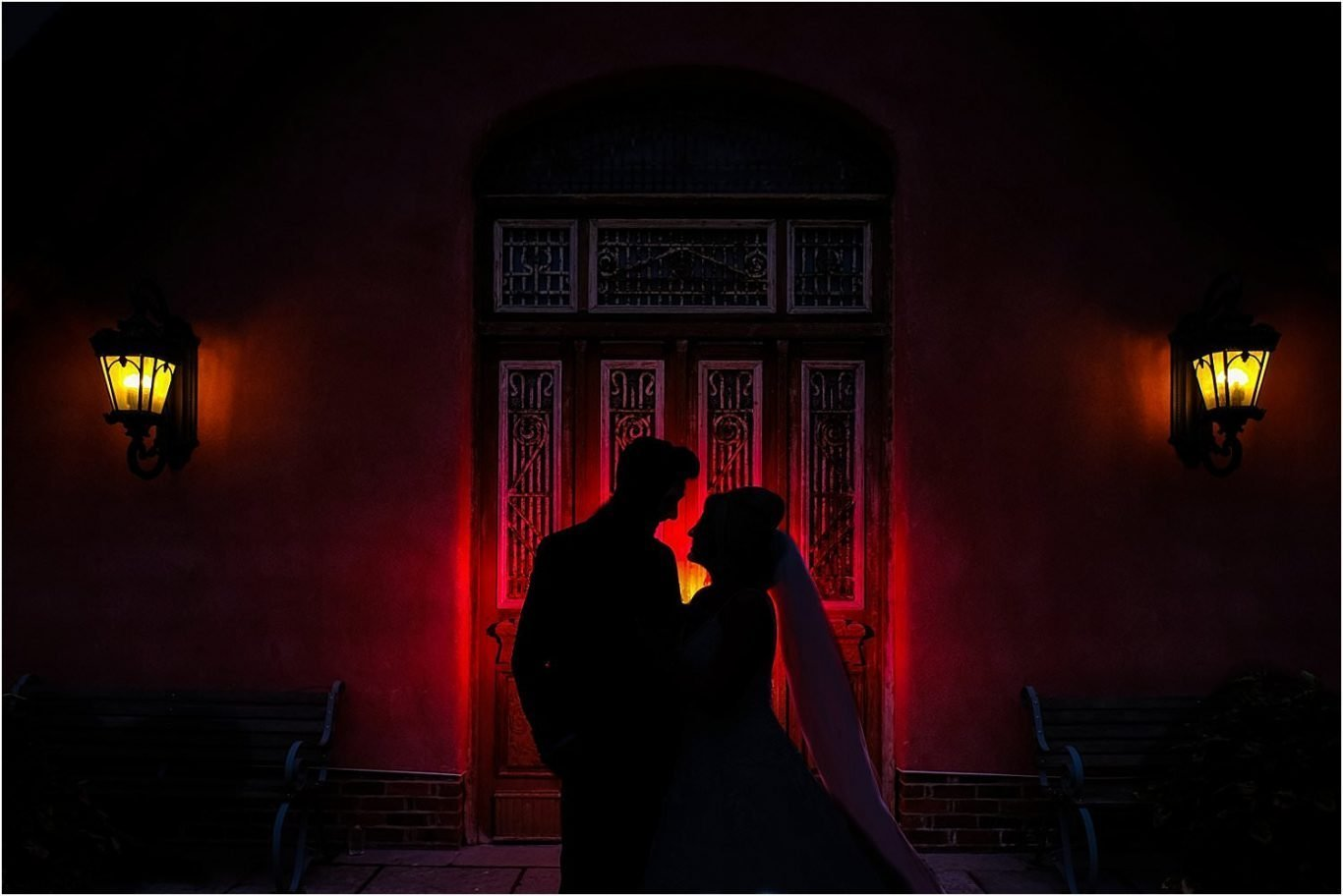 couple in front of red door
