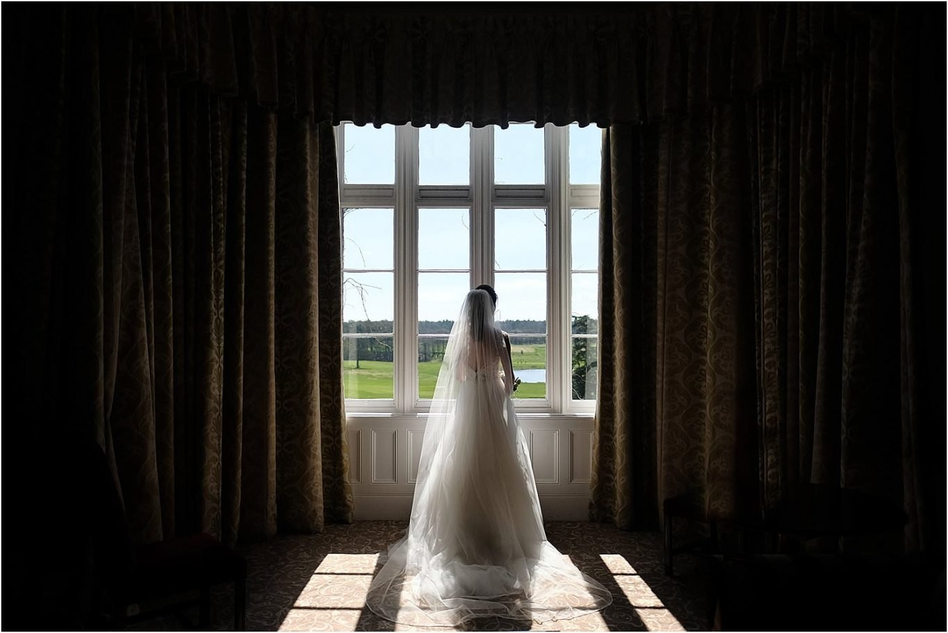 bride in sunlit window