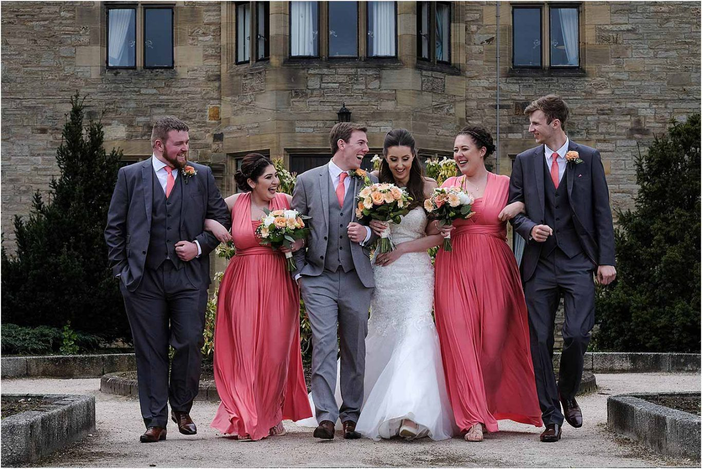 bridal party walking and laughing