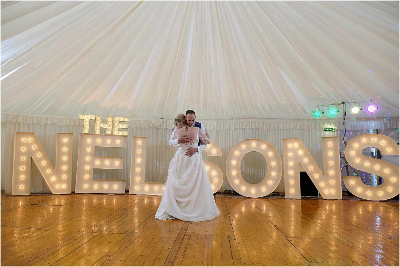 couple dancing with name in background