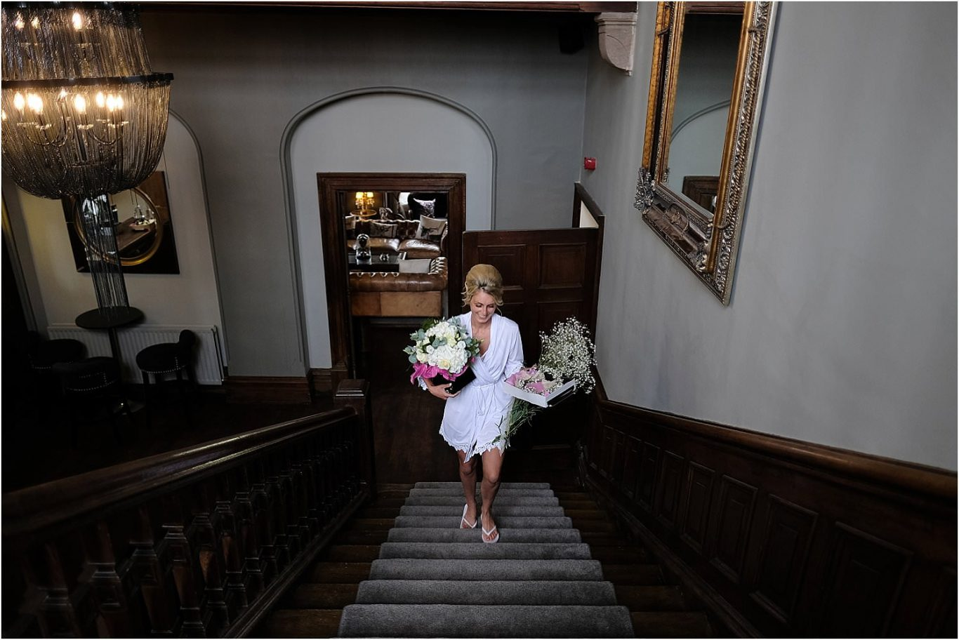 bride walking up stairs with flowers