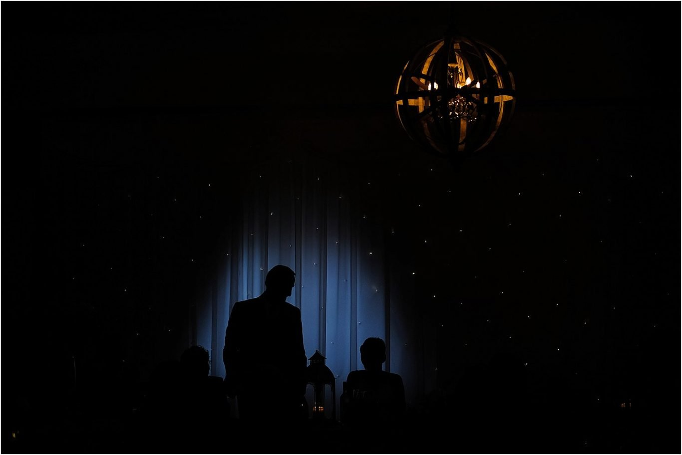 silhoutte of brides father during speeches