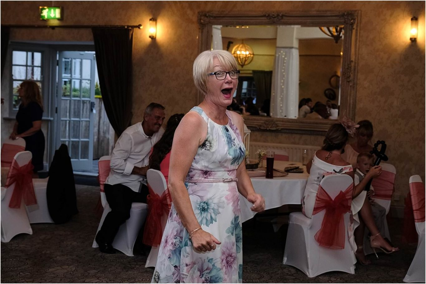 guest laughing on dance floor