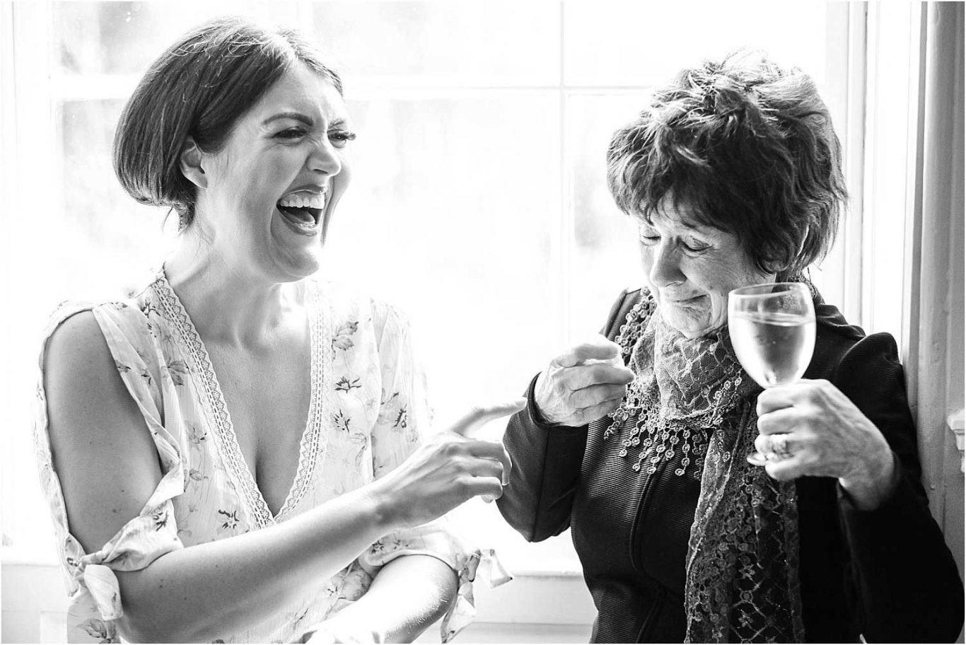 women laughing in window
