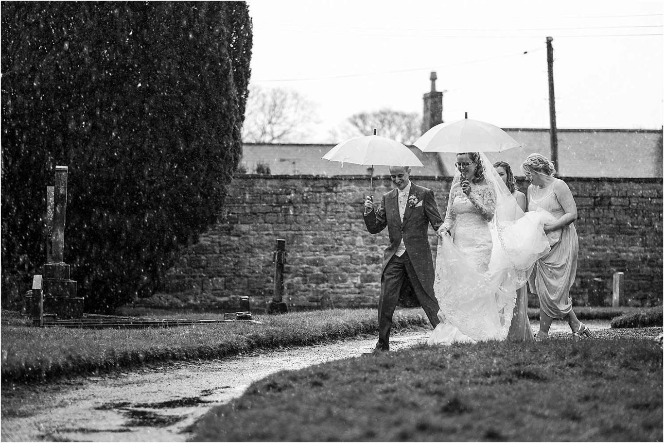 bride and groom exiting church in rain